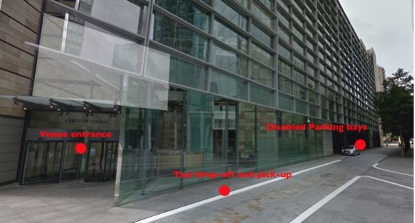 A photograph of the exterior of the venue, showing where taxi drop-off and disabled parking are located